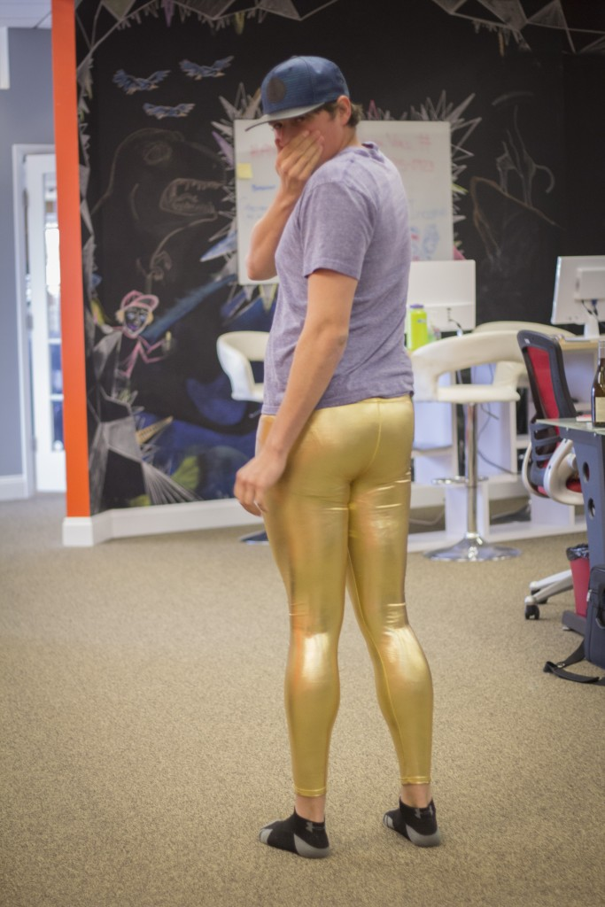 man wearing gold leggings