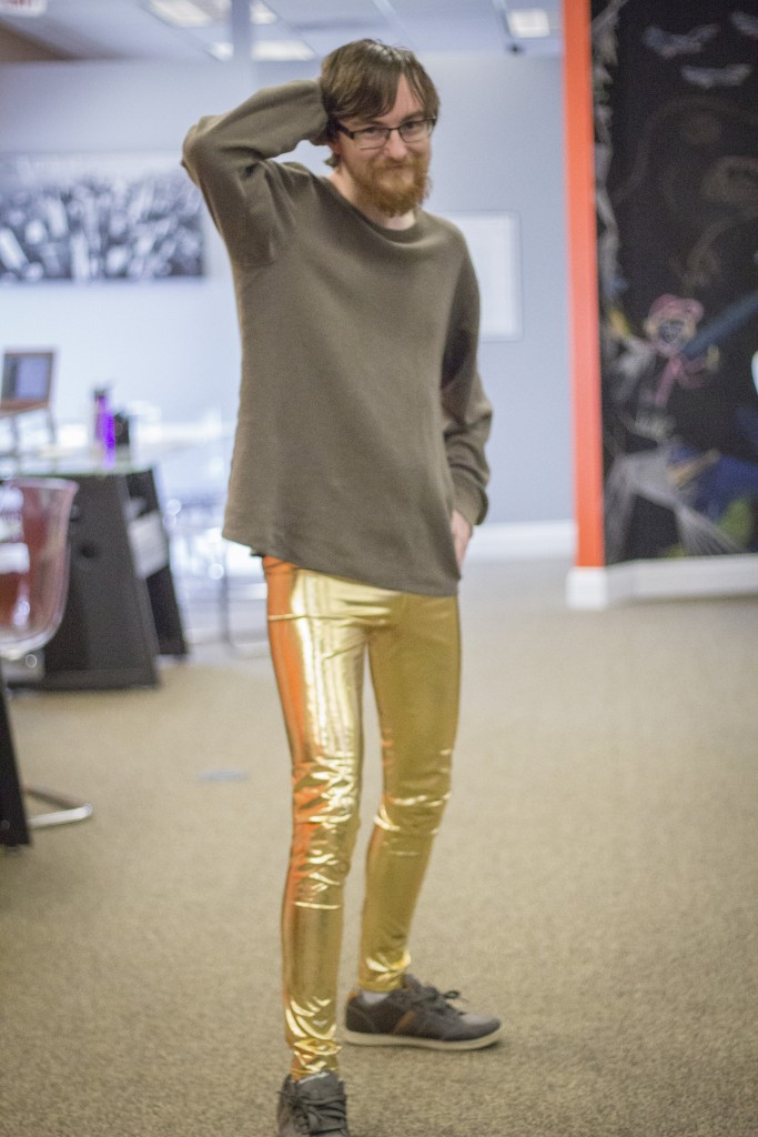man in gold leggings