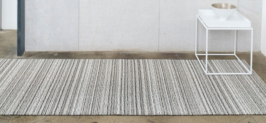 Chilewich woven rug interior design background