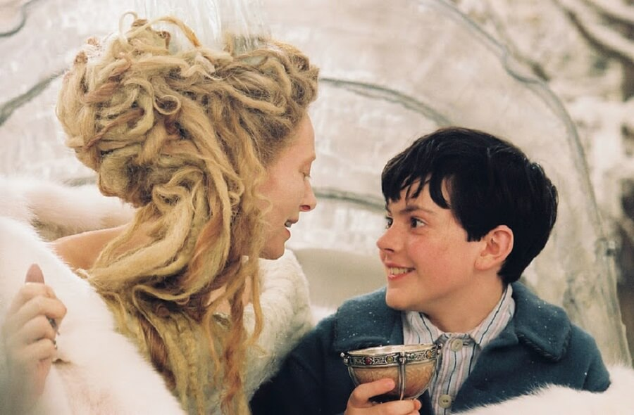 The Queen of Narnia feeding Turkish Delight to Edmund