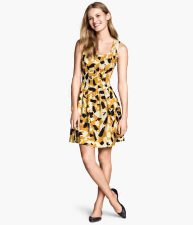 woman in a midi dress smiling happily