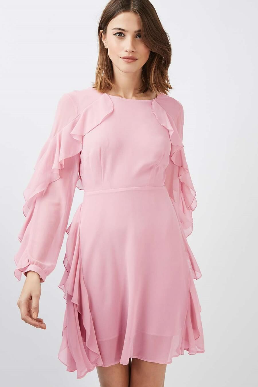 woman wearing a light pink frilly dress