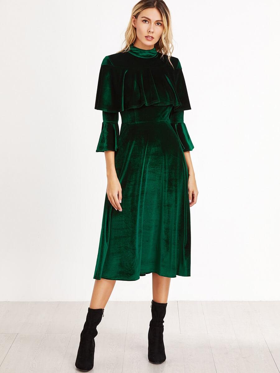 woman wearing a dark green velvet dress