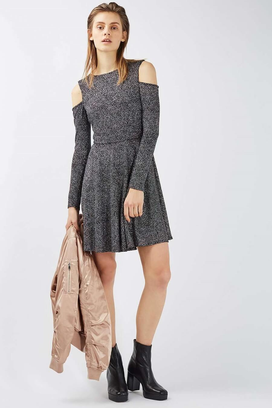 young woman wearing a short glittery dress