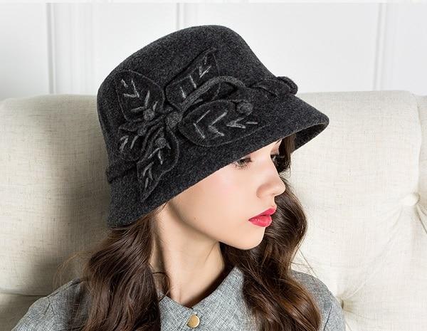 A brunette woman wearing a black hat