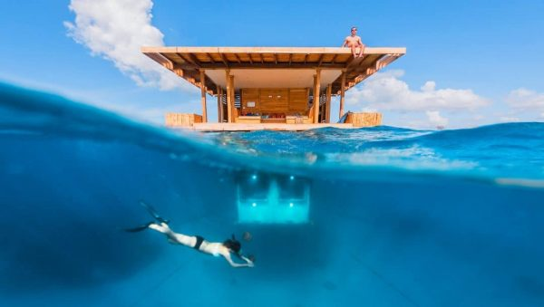 The Tanzania underwater hotel room and someone doing snorkeling near the room