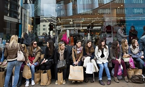 group of shoppers in front of Primark